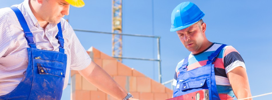 construction site worker checking building walls