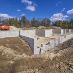 Construction fondations maison.